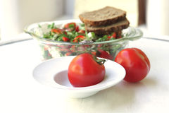 Raw tomato with tomato salad stock photography