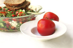 Raw tomato with tomato salad royalty free stock photography
