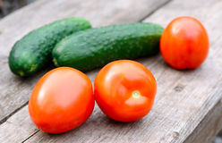 Raw tomatoes and cucumbers Royalty Free Stock Photography