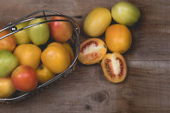 Raw Tomatoes on a wooden background Royalty Free Stock Photo