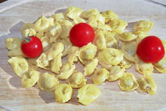 Raw tortellini with cherry tomatoes Stock Photo