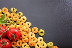 Raw tortellini pasta on black background. Raw tortellini on black background Royalty Free Stock Photos