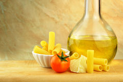 Raw tortiglioni pasta with other ingredients Royalty Free Stock Photography