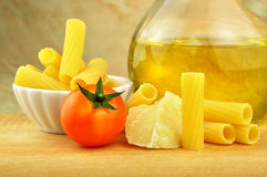 Raw tortiglioni pasta with other ingredients Stock Photography