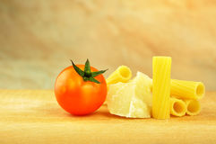 Raw tortiglioni pasta with other ingredients Royalty Free Stock Photo