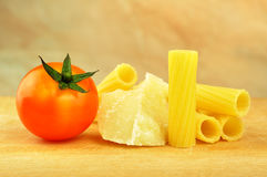 Raw tortiglioni pasta with other ingredients Stock Images