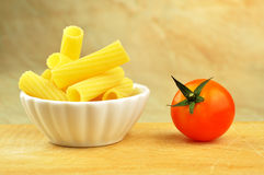 Raw tortiglioni pasta in a small bowl Stock Photo