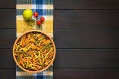 Raw tricolor fusilli or rotini pasta Royalty Free Stock Photo