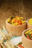 Raw tricolor pasta set on the wooden  table Stock Photography