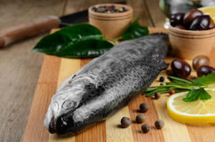 Raw trout on the board Royalty Free Stock Photography