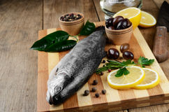 Raw trout on the board Stock Photography