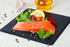 Raw trout fillet. With salt and spices Royalty Free Stock Image