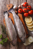 Raw trout with ingredients on a table close-up. vertical top vie Stock Photo
