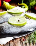 Raw Trout Seasoned with Lime Slices and Peppercorns Stock Image