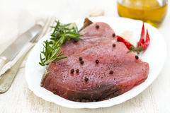 Raw tuna with black pepper on white dish Royalty Free Stock Photography