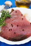 Raw tuna with black pepper on white dish Stock Images