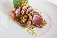 Raw tuna. Boneless raw tuna in spices Stock Photos