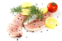 Raw tuna fillet. With pepper and lemon on white background Royalty Free Stock Images