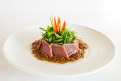 Raw tuna. With herbs in a spicy sauce Royalty Free Stock Photo