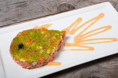 Raw tuna meat with caviar Royalty Free Stock Image