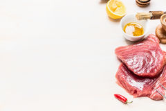 Raw tuna meat and ingredients for grill or cooking on white wooden background Stock Images