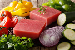 Raw tuna steak with pepper, onions, tomatoes, zucchini and green. S close-up on the table. horizontal Royalty Free Stock Photography
