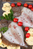 Raw Turbot Fish And Potatoes Stock Photo