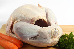 Raw turkey on a board Royalty Free Stock Photography
