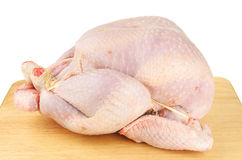 Raw turkey on a board Stock Photography