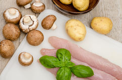 Raw turkey meat with mushrooms and potatoes Royalty Free Stock Image