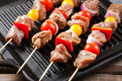 Raw turkey meat skewers with cherry tomatoes, pepper and onion o Royalty Free Stock Image