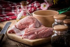 Raw turkey meat. On a wooden chopping board stock image