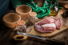 Raw turkey meat. Raw turkey meat on a wooden chopping board Royalty Free Stock Photography