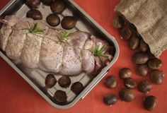 Raw turkey in tray with chestnut stock photo