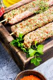 Kebab of lamb with herbs. Raw turkish traditional dish meat kebab with herbs and spices.Eastern food Royalty Free Stock Photography