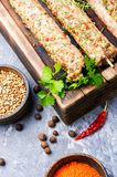 Kebab of lamb with herbs. Raw turkish traditional dish meat kebab with herbs and spices.Eastern food Stock Photography