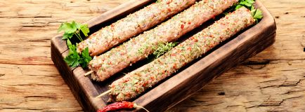 Kebab of lamb with herbs. Raw turkish traditional dish meat kebab with herbs and spices Stock Photo