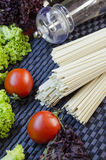 Raw udon noodles. And vegetables for cooking dishes Stock Images