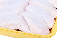 Raw uncooked chicken wings. In package, closeup Stock Images