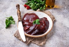 Raw uncooked  liver and spices for cooking. Selective focus Stock Image