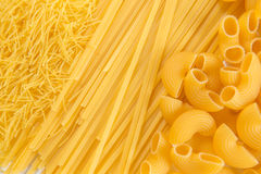 Raw uncooked pasta in bowl Royalty Free Stock Image