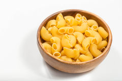 Raw uncooked pasta in bowl Royalty Free Stock Photo