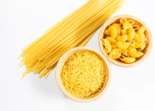 Raw uncooked pasta in bowl Royalty Free Stock Photography