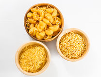 Raw uncooked pasta in bowl Royalty Free Stock Photos
