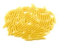 Raw uncooked pasta macaroni. On white background royalty free stock images