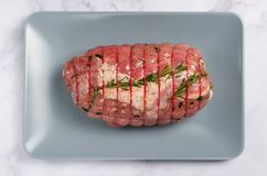 Raw Uncooked Pork, Rolled Meat with Herbs and Seasoning. On Grey Background Stock Images