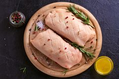 Raw uncooked poultry meat cut on wooden tray. Duck breasts with honey, rosemary and spices. Raw uncooked poultry meat cut on wooden tray. Duck breasts with royalty free stock photography
