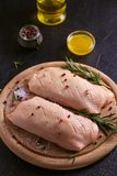 Raw uncooked poultry meat cut on wooden tray. Duck breasts with honey, rosemary and spices. Raw uncooked poultry meat cut on wooden tray. Duck breasts with stock images