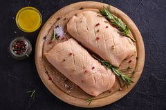 Raw uncooked poultry meat. Duck breasts prepared for cooking. Raw uncooked poultry meat. Duck breasts prepared for cooking royalty free stock images