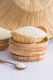 Raw and uncooked rice in basket weave. Stock Image